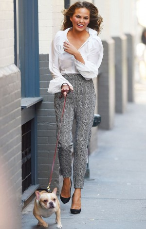 Daily Chrissy Teigen's dog stroll in Elisabetta Franchi total look
